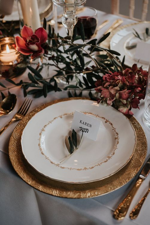 Opulent Place Setting In Reds And Golds Winter Wedding