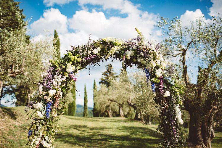 Floral Arch | Outdoor Wedding at Borgo Bastia Creti in Italy | Paolo Ceritano Photography