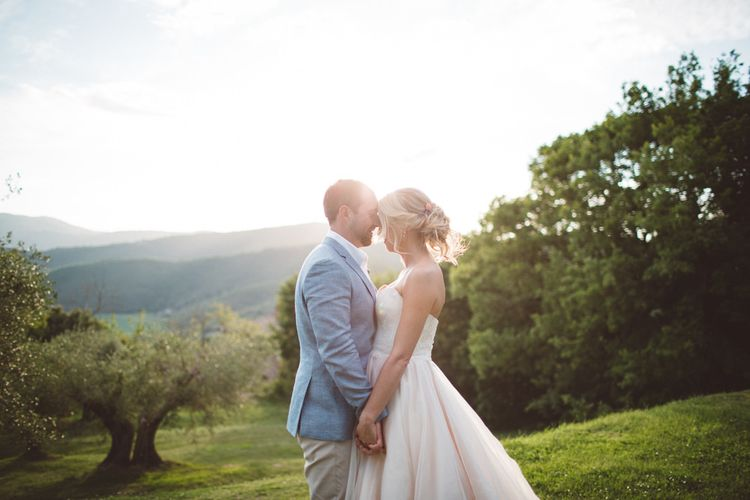 Sunsets | Bride in Lyn Ashworth Wedding Dress | Groom in Light Blue Jacket | Outdoor Wedding at Borgo Bastia Creti in Italy | Paolo Ceritano Photography