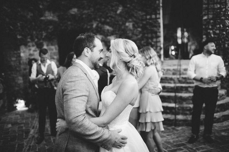 First Dance | Bride in Lyn Ashworth Wedding Dress | Groom in Light Blue Jacket | Outdoor Wedding at Borgo Bastia Creti in Italy | Paolo Ceritano Photography