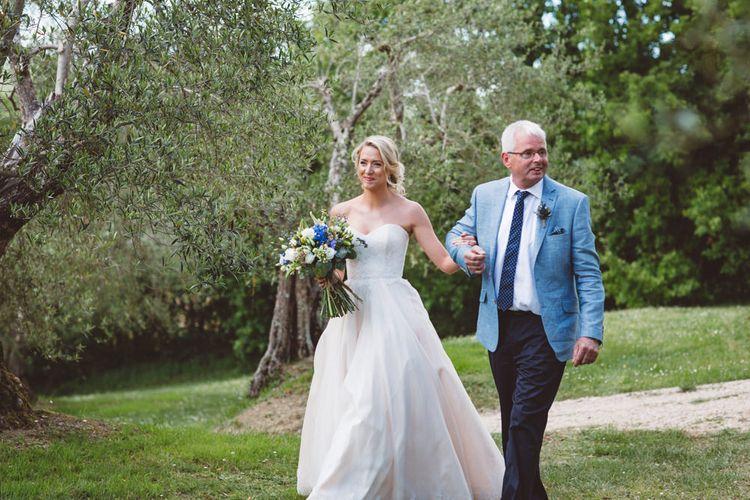 Bridal Entrance in Lun Ashworth Dress | Outdoor Wedding at Borgo Bastia Creti in Italy | Paolo Ceritano Photography