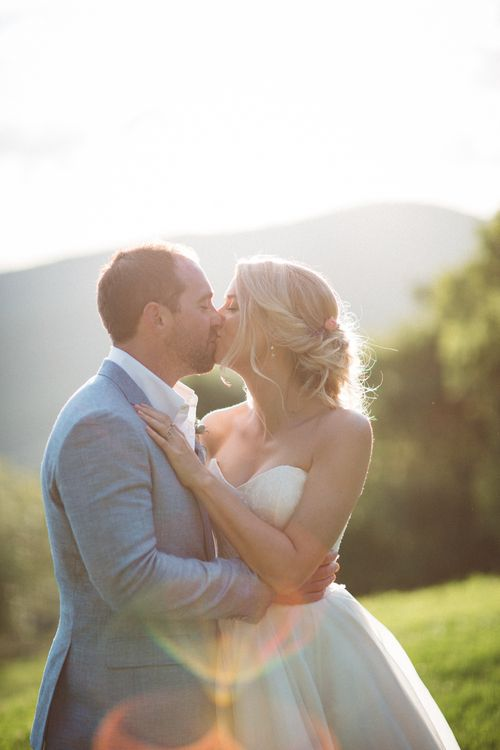 Sunset | Bride in Lyn Ashworth Wedding Dress | Groom in Light Blue Jacket | Outdoor Wedding at Borgo Bastia Creti in Italy | Paolo Ceritano Photography