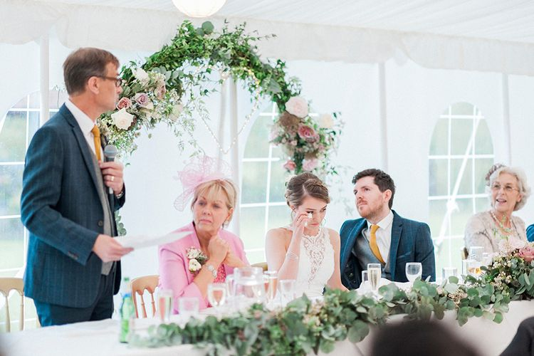 Floral Arch Top Table Backdrop | Lantern Filled Marquee Reception | Romantic Pastel Wedding at Prested Hall, Essex | Kathryn Hopkins Photography | Sugar Lens Productions