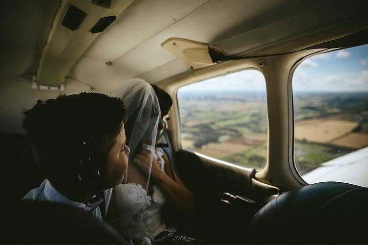 Bride Flying Into Wedding On A Plane