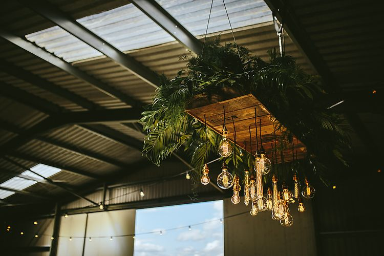 Edison Bulb Light Installation For An Industrial Wedding At Northumberland Airfield