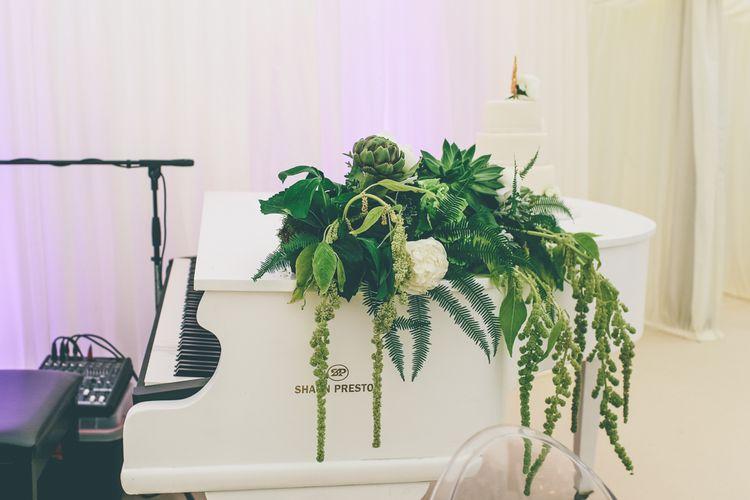 White Grand Piano At Wedding