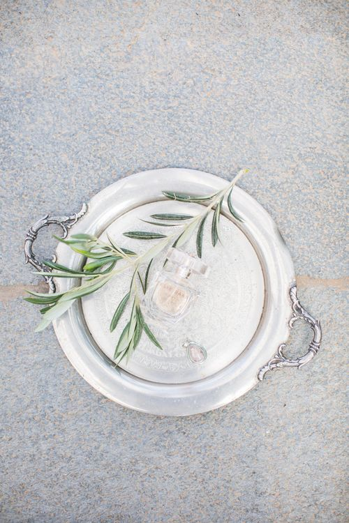 Wedding Perfume & Necklace on Silver Platter   Intimate Outdoor Destination Wedding at Kinsterna Hotel & Spa in Greece   Cecelina Photography