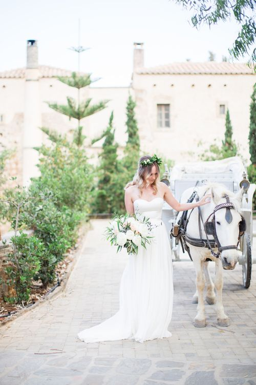 Bride in BHLDN Wedding Dress   House & Carriage   Intimate Outdoor Destination Wedding at Kinsterna Hotel & Spa in Greece   Cecelina Photography