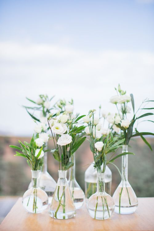 White Flower Stems inVases   Intimate Outdoor Destination Wedding at Kinsterna Hotel & Spa in Greece   Cecelina Photography