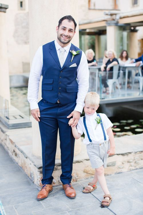 Groom in Navy Blue Ted Baker Suit & Page Boy in Shorts & Braces   Intimate Outdoor Destination Wedding at Kinsterna Hotel & Spa in Greece   Cecelina Photography