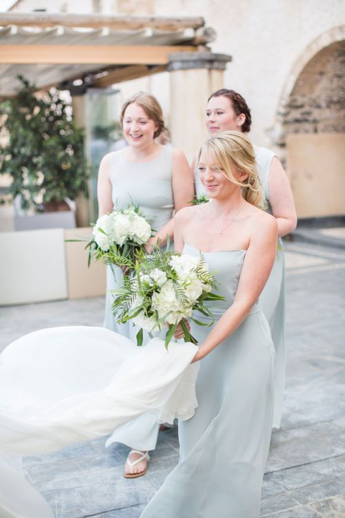 Bridesmaids in Pale Blue House of Fraser Dresses   Intimate Outdoor Destination Wedding at Kinsterna Hotel & Spa in Greece   Cecelina Photography