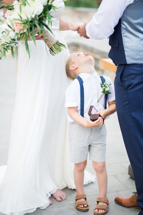 Page Boy in Shorts & Braces   Intimate Outdoor Destination Wedding at Kinsterna Hotel & Spa in Greece   Cecelina Photography