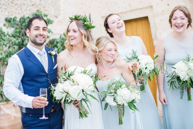 Bride in BHLDN Wedding Dress   Bridesmaids in Pale Blue House of Fraser Dresses   Groom in Blue Ted Baker Suit   Kinsterna Hotel & Spa in Greece   Cecelina Photography