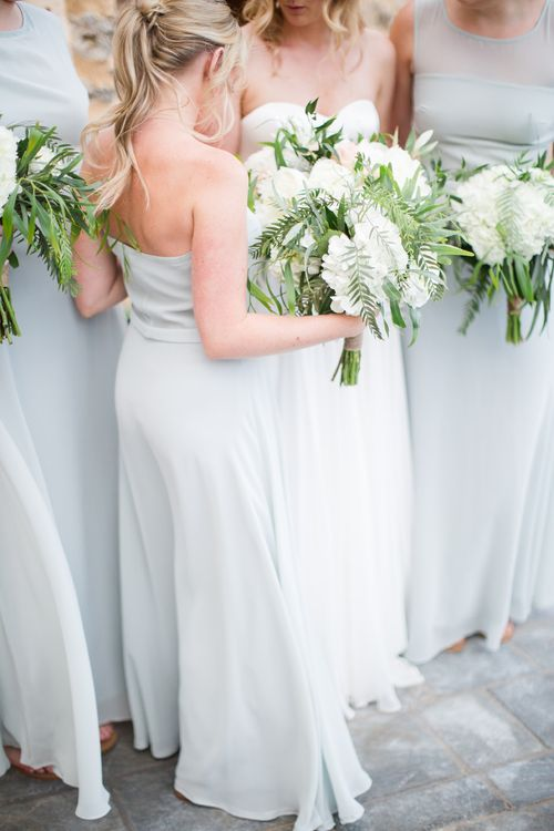 Bridesmaids in Powder Blue House of Fraser Dresses with White & Greenery Bouquets   Intimate Outdoor Destination Wedding at Kinsterna Hotel & Spa in Greece   Cecelina Photography