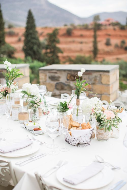 Jars & Bottles filled with Flower Stems   Wedding Decor   Intimate Outdoor Destination Wedding at Kinsterna Hotel & Spa in Greece   Cecelina Photography