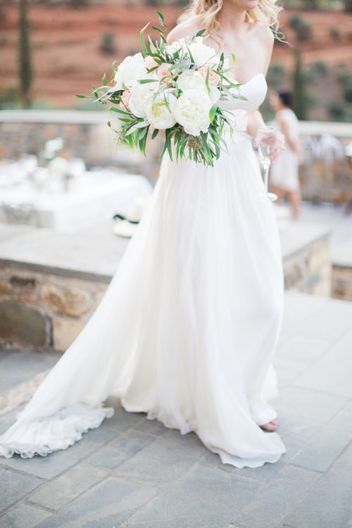 Bride in BHLDN Gown with White & Peach Bouquet   Intimate Outdoor Destination Wedding at Kinsterna Hotel & Spa in Greece   Cecelina Photography