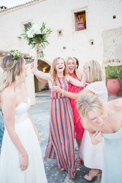 Catching the Bouquet   Intimate Outdoor Destination Wedding at Kinsterna Hotel & Spa in Greece   Cecelina Photography