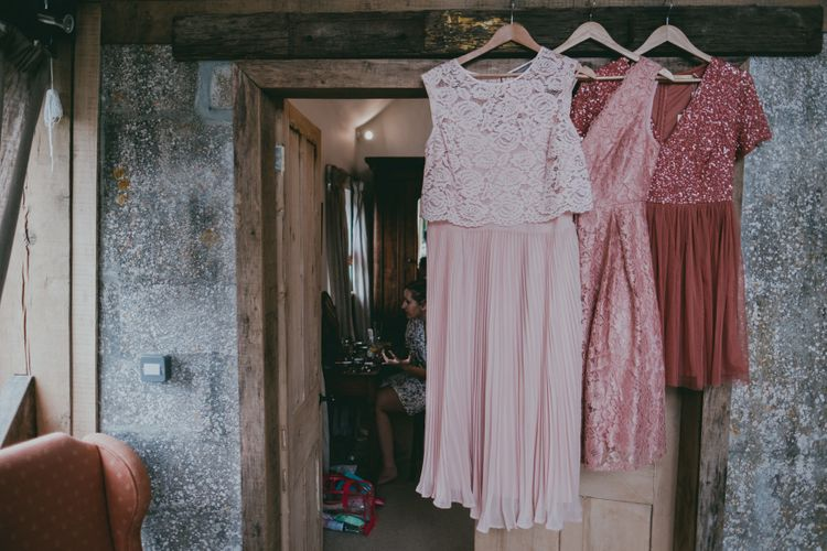 Pink Highstreet Bridesmaid Dresses | Coral Wedding Cake with Peony Decor | Bride in Anna Campbell Gown from Coco & Kate Boutique | Groom in Next Wool Suit | Rustic Barn Pink Summer Wedding at Nancarrow Farm in Cornwall | Ross Talling Photography