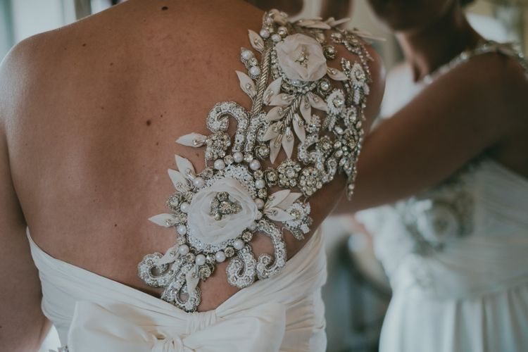One Shoulder Anna Campbell Gown from Coco & Kate Boutique | Coral Wedding Cake with Peony Decor | Bride in Anna Campbell Gown from Coco & Kate Boutique | Groom in Next Wool Suit | Rustic Barn Pink Summer Wedding at Nancarrow Farm in Cornwall | Ross Talling Photography
