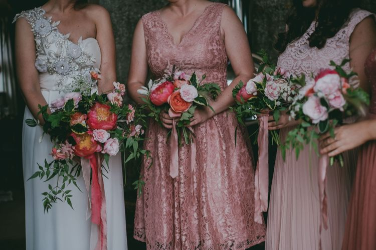 Peony & Rose Bouquets | Coral Wedding Cake with Peony Decor | Bride in Anna Campbell Gown from Coco & Kate Boutique | Groom in Next Wool Suit | Rustic Barn Pink Summer Wedding at Nancarrow Farm in Cornwall | Ross Talling Photography