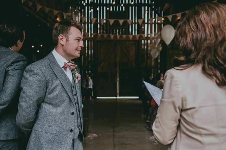 Groom in Grey Wool Next Suit | Coral Wedding Cake with Peony Decor | Bride in Anna Campbell Gown from Coco & Kate Boutique | Groom in Next Wool Suit | Rustic Barn Pink Summer Wedding at Nancarrow Farm in Cornwall | Ross Talling Photography