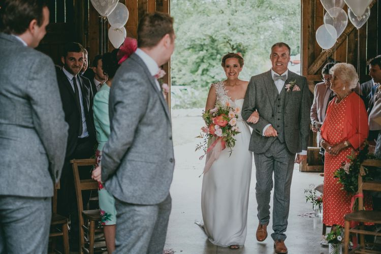 Wedding Ceremony | Bridal Entrance in Anna Campbell Gown from Coco & Kate Boutique | Coral Wedding Cake with Peony Decor | Bride in Anna Campbell Gown from Coco & Kate Boutique | Groom in Next Wool Suit | Rustic Barn Pink Summer Wedding at Nancarrow Farm in Cornwall | Ross Talling Photography