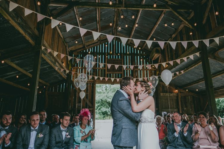 Wedding Ceremony | Bride in Anna Campbell Gown | Groom in Grey Wool Suit | Coral Wedding Cake with Peony Decor | Bride in Anna Campbell Gown from Coco & Kate Boutique | Groom in Next Wool Suit | Rustic Barn Pink Summer Wedding at Nancarrow Farm in Cornwall | Ross Talling Photography