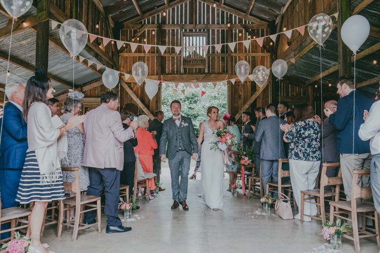 Wedding Ceremony | Liberty Print bunting | Balloon Decor | Bride in Anna Campbell Gown | Groom in Grey Wool Suit | Coral Wedding Cake with Peony Decor | Bride in Anna Campbell Gown from Coco & Kate Boutique | Groom in Next Wool Suit | Rustic Barn Pink Summer Wedding at Nancarrow Farm in Cornwall | Ross Talling Photography