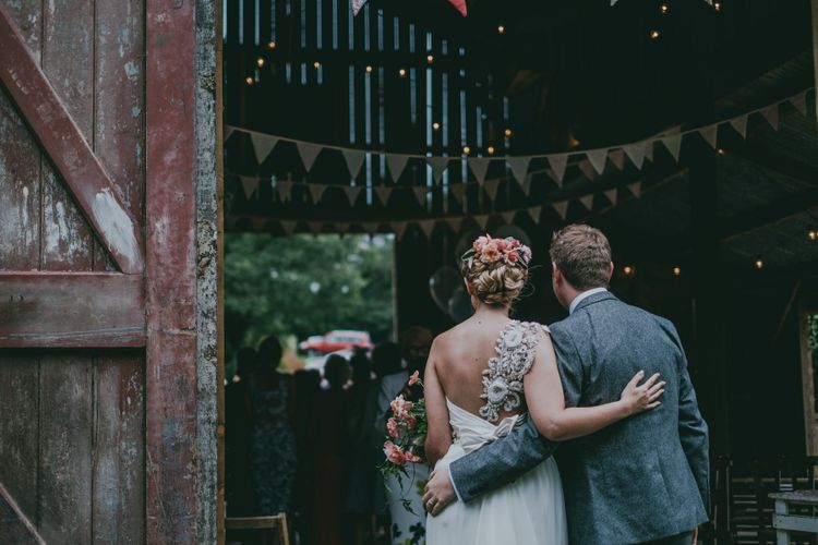 Bride in Anna Campbell Gown | Groom in Grey Wool Suit | Coral Wedding Cake with Peony Decor | Bride in Anna Campbell Gown from Coco & Kate Boutique | Groom in Next Wool Suit | Rustic Barn Pink Summer Wedding at Nancarrow Farm in Cornwall | Ross Talling Photography