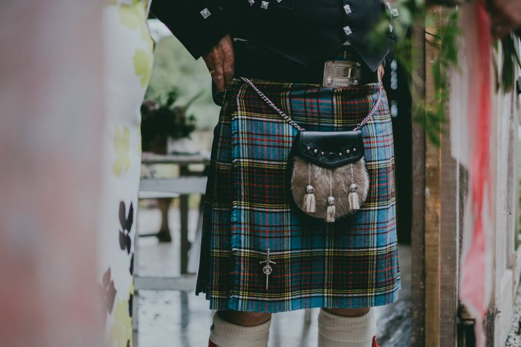 Tartan Kilt | Coral Wedding Cake with Peony Decor | Bride in Anna Campbell Gown from Coco & Kate Boutique | Groom in Next Wool Suit | Rustic Barn Pink Summer Wedding at Nancarrow Farm in Cornwall | Ross Talling Photography