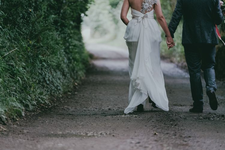 Bride in Anna Campbell Gown from Coco & Kate Boutique | Groom in Next Wool Suit | Rustic Barn Pink Summer Wedding at Nancarrow Farm in Cornwall | Ross Talling Photography