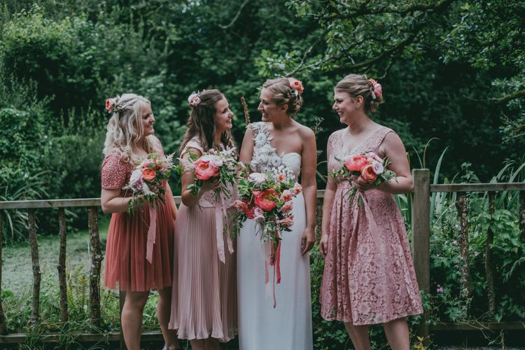 Bridesmaids in Highstreet Pink Dresses | Bride in Anna Campbell Gown from Coco & Kate Boutique | Rustic Barn Pink Summer Wedding at Nancarrow Farm in Cornwall | Ross Talling Photography
