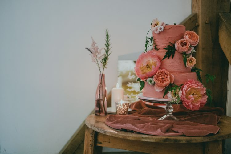 Coral Wedding Cake with Peony Decor | Bride in Anna Campbell Gown from Coco & Kate Boutique | Groom in Next Wool Suit | Rustic Barn Pink Summer Wedding at Nancarrow Farm in Cornwall | Ross Talling Photography