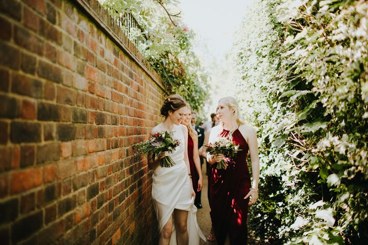 Bride & Bridesmaids in Burgundy Dresses | Petersham Nurseries Botanical Wedding | Irene Yap Photography