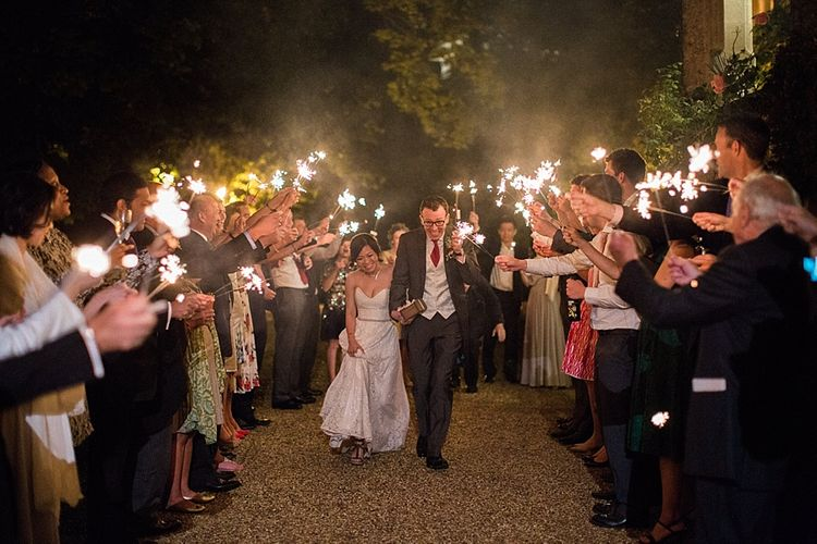 Sparkler Exit | Bride in Renee L. Collections Gown | Groom in Moss Bros Traditional Suit | Jacob & Pauline Photography | Pretty in White Films