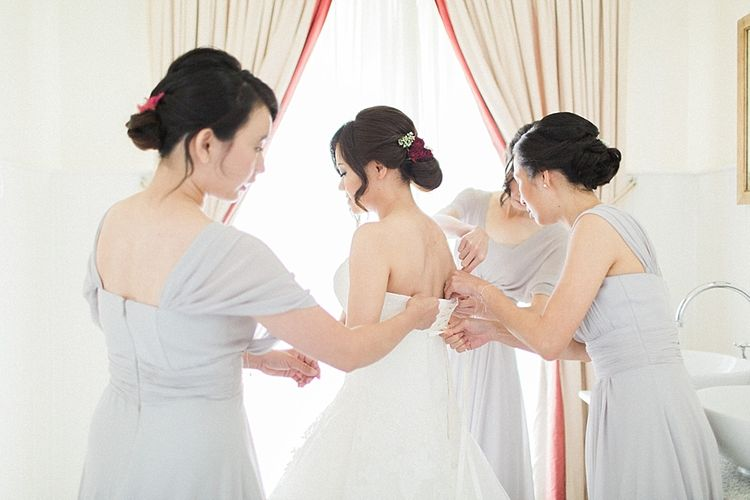 Getting Ready | Bride in Renee L. Collections Gown | Bridesmaids in Grey Love Potion Dresses | Jacob & Pauline Photography | Pretty in White Films