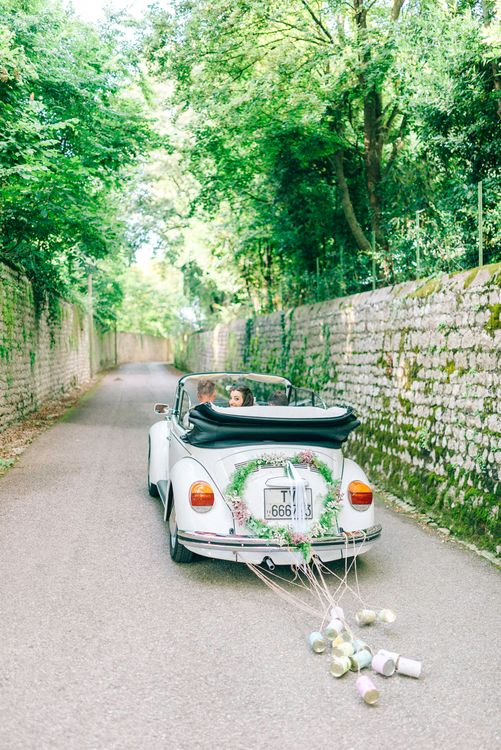 White Beetle Wedding Car with Tin Cans