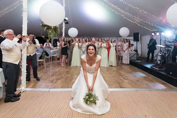 Throwing The Bouquet // Elegant & Classic Sail Cloth Tent Wedding At Wickham House With Bride In Pronovias And Images From Fine Art Photographer Julie Michaelsen