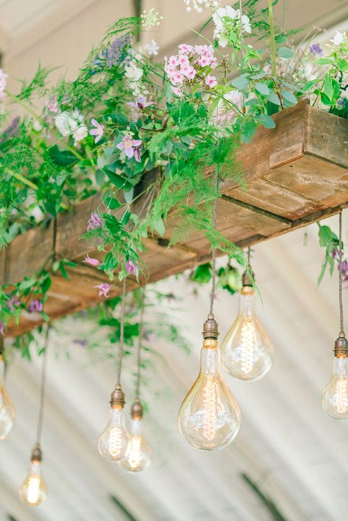 Edison Bulb Light Installation With Flowers