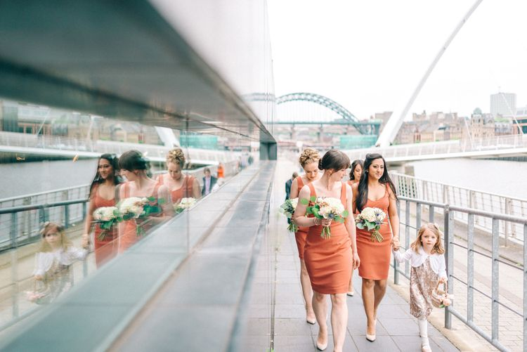 Bridesmaids in Coral Reiss Dresses