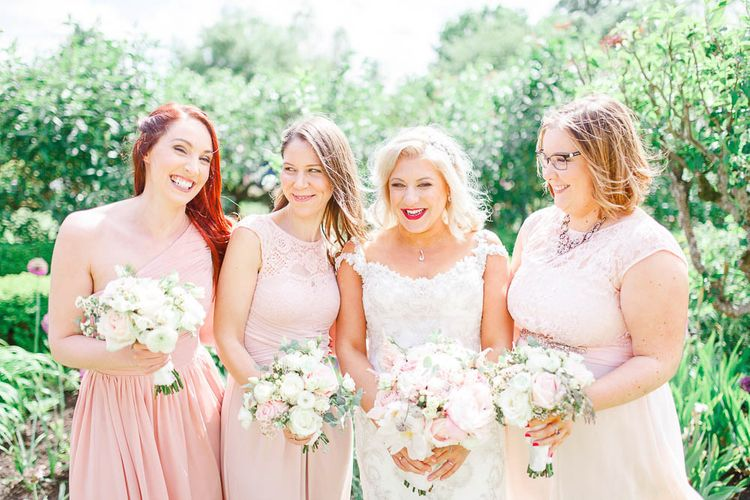 Bridesmaids in different Blush Pink Dresses | Bride in Sottero & Midgley Beaded Gown | White Stag Wedding Photography