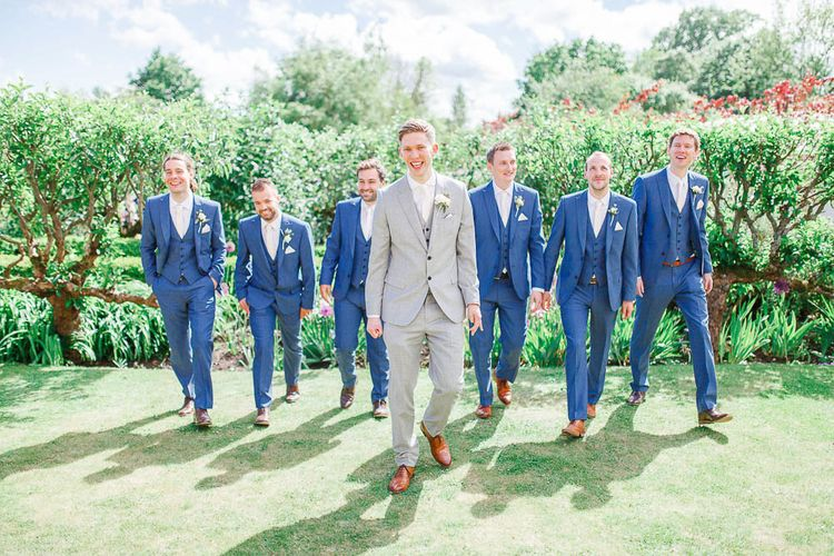 Groom in Light Grey Reiss Suit | Groomsmen in Navy Moss Bros Suits | White Stag Wedding Photography
