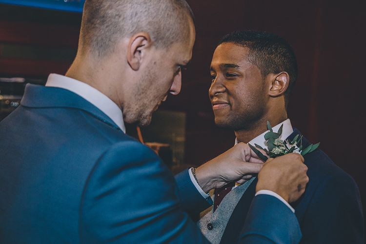 Buttonhole   Groom in The Bespoke Club Navy Suit   Stylish London Wedding Planned by Revelry Events   Story + Colour Photography