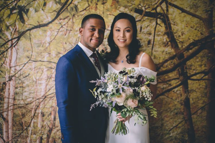 Wedding Ceremony   Bride in Reformation Poppy Gown   Groom in Navy Bespoke Club Suit   Stylish London Wedding Planned by Revelry Events   Story + Colour Photography