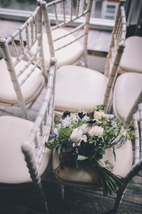 Aisle Floral Chair Decor   Stylish London Wedding Planned by Revelry Events   Story + Colour Photography