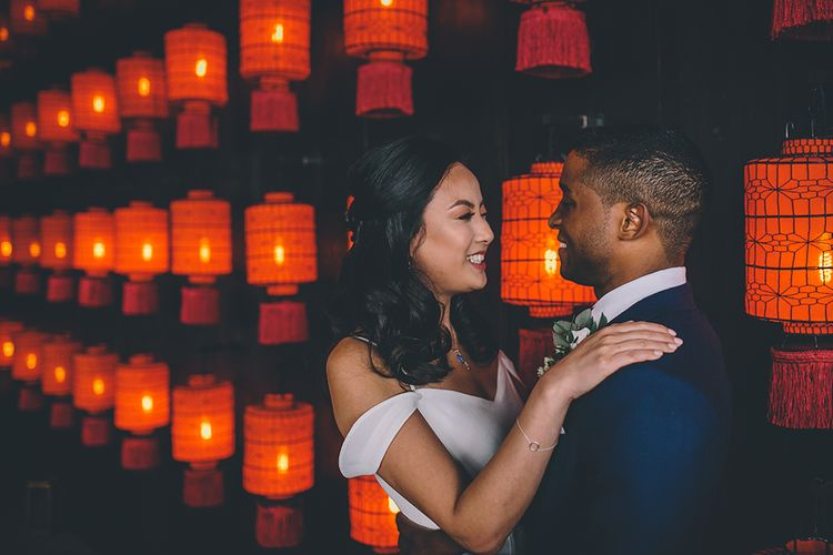 Bride in Reformation Poppy Gown   Groom in Navy Bespoke Club Suit   Stylish London Wedding Planned by Revelry Events   Story + Colour Photography