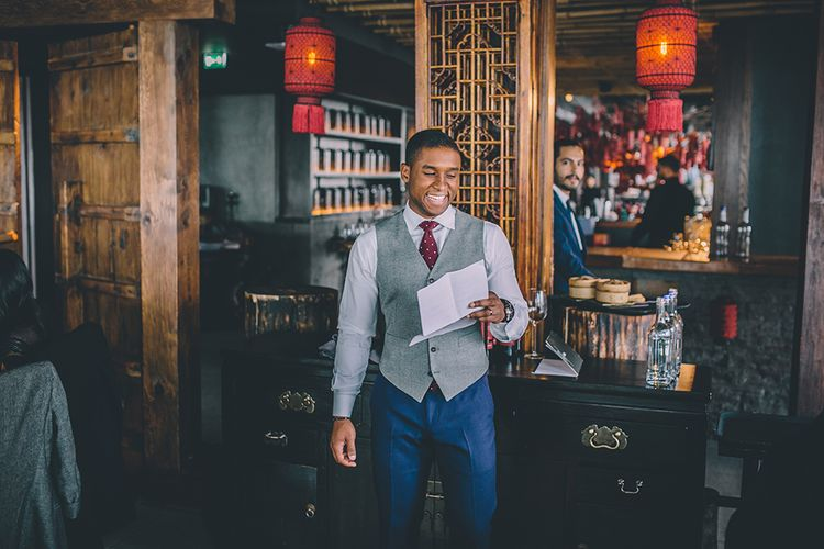 Groom in Navy Bespoke Club Suit   Stylish London Wedding Planned by Revelry Events   Story + Colour Photography