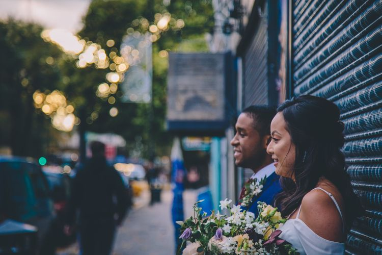 Bride in Reformation Poppy Gown   Groom in Tailored The Bespoke Club Navy Suit   Stylish London Wedding Planned by Revelry Events   Story + Colour Photography