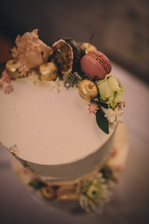Iced Wedding Cake by Butter Beautiful with Macaroon & gold Cherry Decor   Stylish London Wedding Planned by Revelry Events   Story + Colour Photography