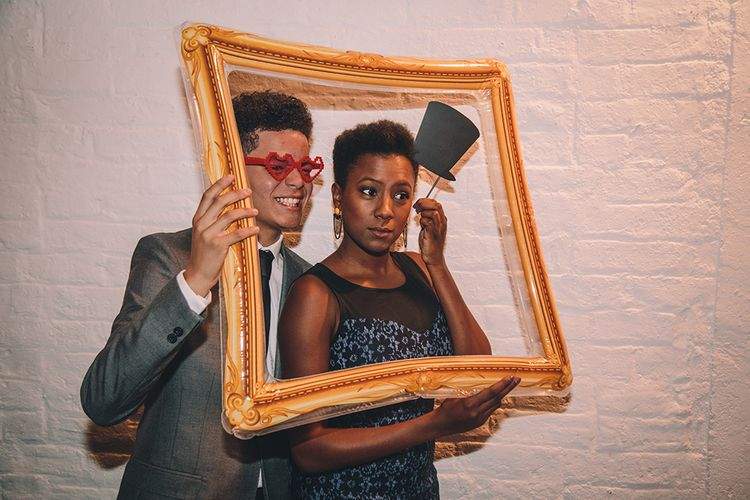 Photo Booth Props   Stylish London Wedding Planned by Revelry Events   Story + Colour Photography